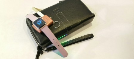 A wallet that charges your devices while you travel hassle free