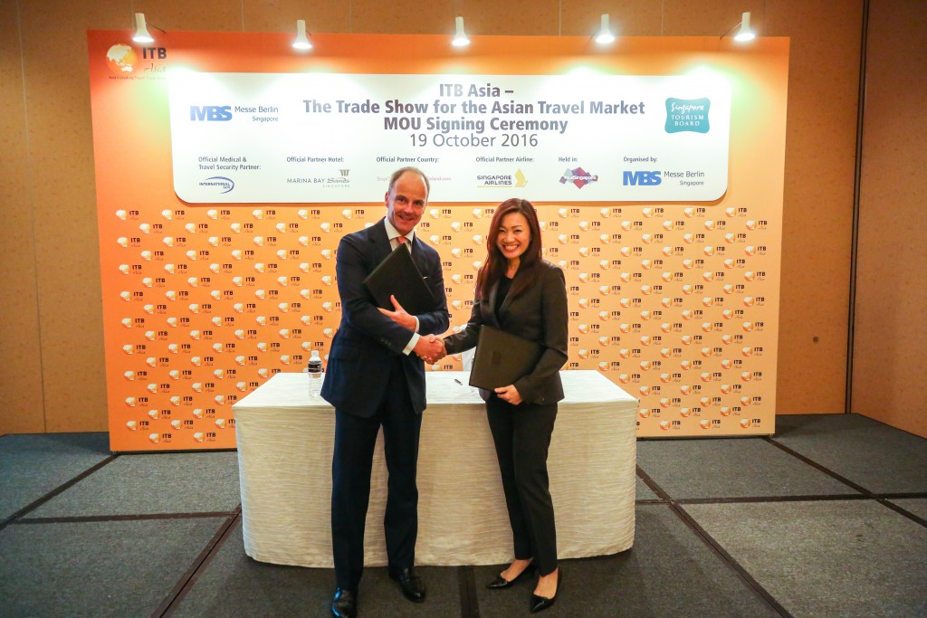 Dr. Christian Goke, CEO, Messe Berlin GmbH and Ms. Melissa Ow, Deputy Chief Executive of the Singapore Tourism Board at the MOU Signing Ceremony