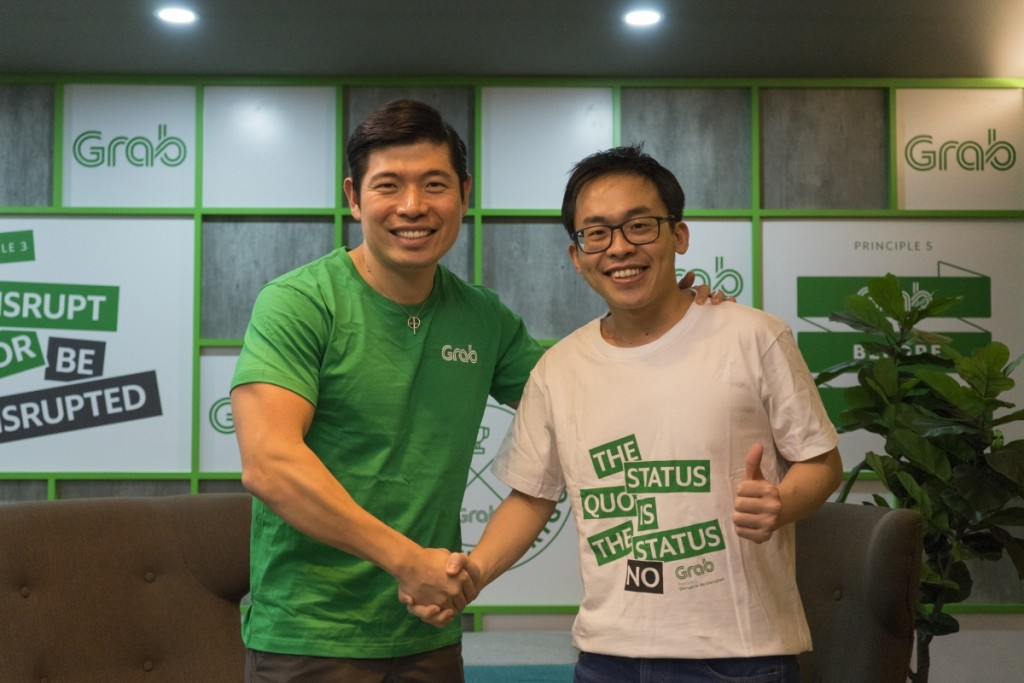 Grab CEO and co-founder Anthony Tan (left), together with Albert Lucius, CEO of Kudo (right)